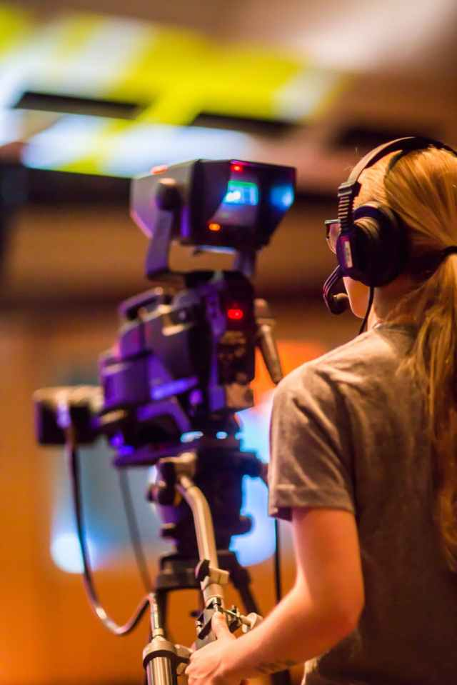 woman standing in front of video camera