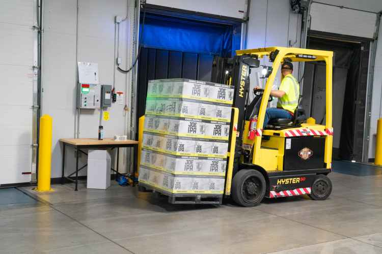 man riding on yellow forklift